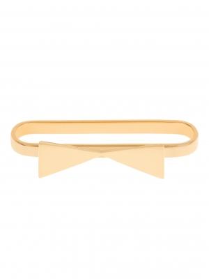 Złota nausznica z kokardką minimalistyczna biżuteria moie